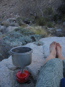 Boiling up some water to re-hydrate some dry dinner fixin's. No shoes, no shirt, no problem at this desert diner at the Sheep Canyon oasis.