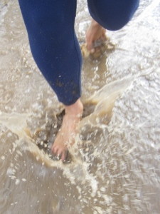 Barefoot puddle running