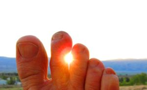The sunrise: over the White Mountains and through my toes.
