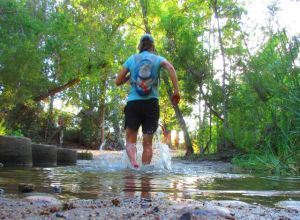 At the end of yesterday's non-painful run: a happy splash through Santiago Creek . . .