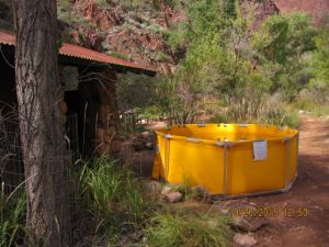 What a mirage: what almost appears to be some sort of soaking tub at the Bright Angel Campground turned out to be . . . toilet flushing water! Buckets are available next to the toilets; users are supposed to dump a bucket of water into the toilet to create a flush . . . all because of water shut-offs due to pipeline repair in the area.