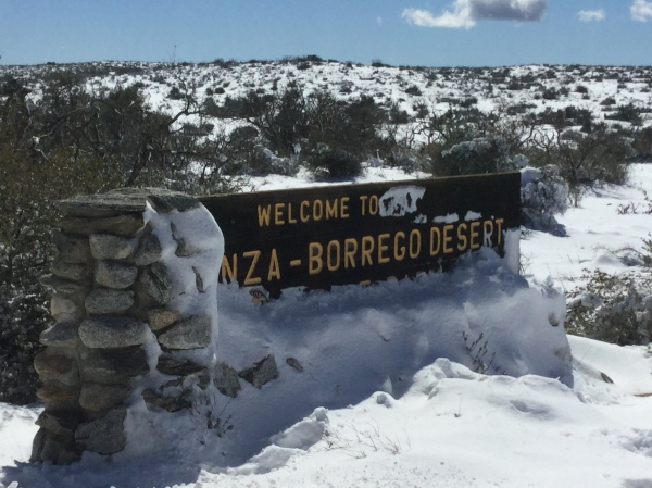anza borrego welcome sign covered with snow