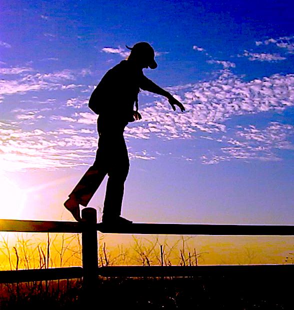 barefoot fence walk sunset