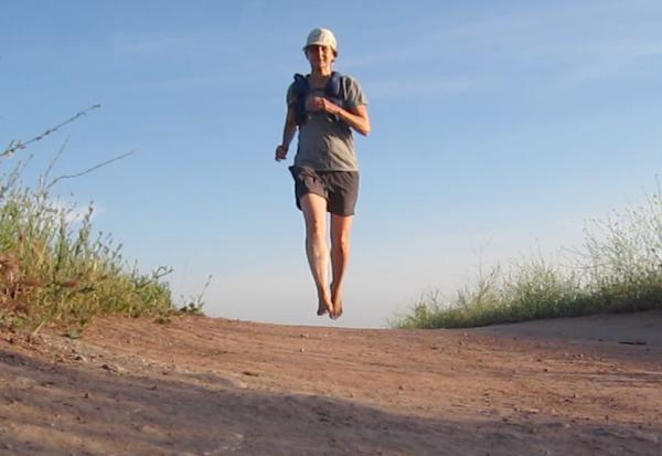 barefoot runner on the horizon